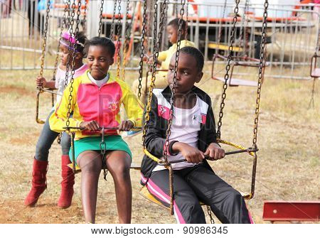 Black African Children Waiting For Roundabout Ride To Start