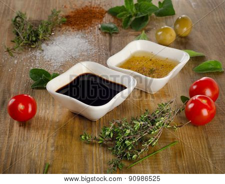 Dressing Ingredients On A Rustic Background.