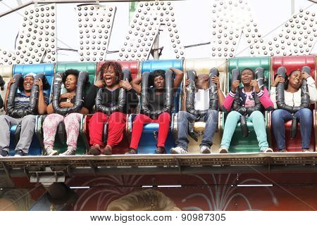 Black African People Enjoying Rise And Fall Electronic Ride