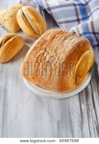 Loaf Of Bread On A Wooden Cutting Board.