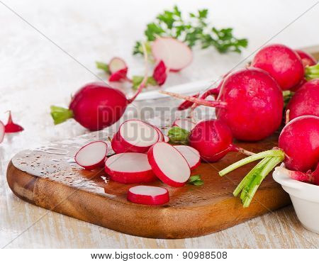 Fresh Radishes On A  Wooden Board.