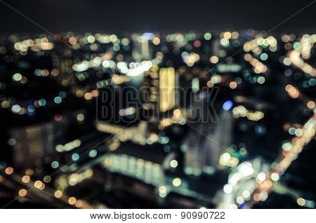 abstract blurred circular bokeh background of moving city night light with filtered color.