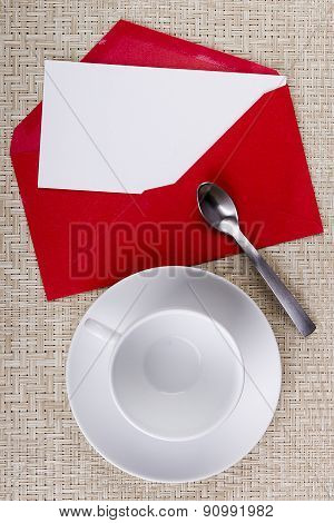 Empty Tea Cup And An Envelope