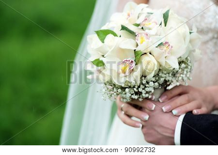 Betrothed Pair Holding A Delicate Bouquet
