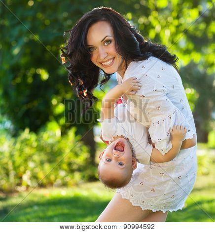 Portrait Of A Mother And Her Baby Having Fun