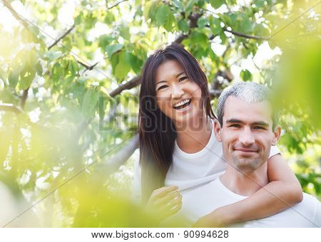 Beautiful Couple At The Park Looking Very Happy