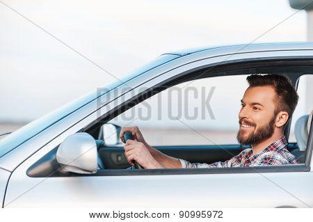 Riding His New Car.