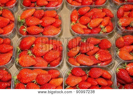 An Array Of Strawberry Punnets At A Farmer's Market