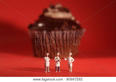 Funny Rendition of Miniature Chefs With Cupcake