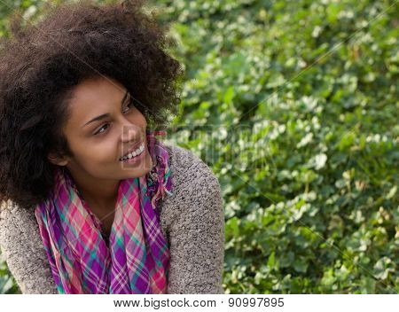 Smiling African American Woman Sitting On Grass