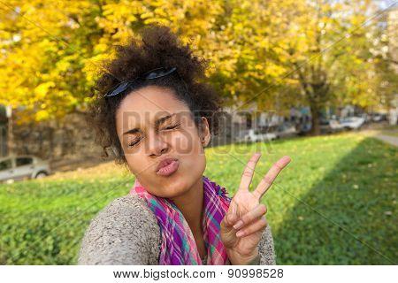 Selfie Portrait Of A Cute Girl Making Face
