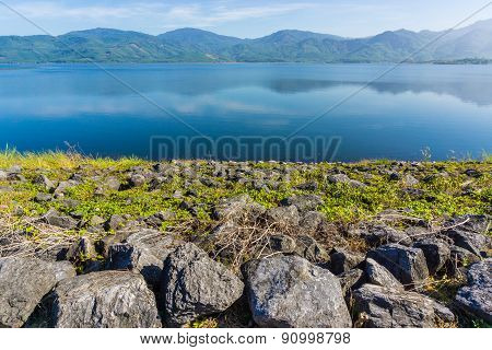View Of Reservoir Blue Sky And Green Grass