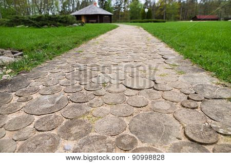Wooden Round Log Path Closeup In Summer Recreation Camping Site