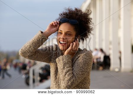 Happy Young Woman Listening To Music On Earphones