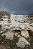 stock photo of ram  - Stone piece with carved ram head in ruins at Antioch Pisidian in Turkey - JPG
