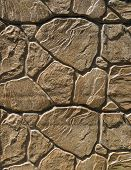 stock photo of tile cladding  - Brown cladding tiles imitating stones in sunny day - JPG