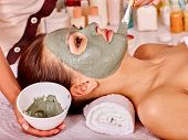 pic of beauty parlour  - Woman with green clay facial mask in beauty spa - JPG