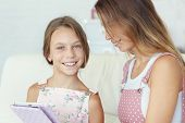 image of preteens  - Mother with her preteen daugher playing ipad together - JPG