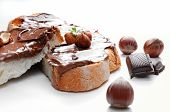 pic of hazelnut  - Two slices of bread with chocolate cream and hazelnuts white isolated front view - JPG