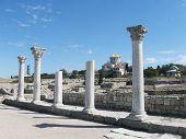image of sevastopol  - Ancient city Chersonesos Tauric, famous columns  and wall of Basilica 1935 (VI-X c.) - symbol of Chersonese,   look through on St. Vladimir