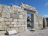 stock photo of sevastopol  - Ancient city Chersonesos Tauric,wall of famous Basilica  1935 (VI-X c.) - symbol of Chersonese, look through doorway on St. Vladimir