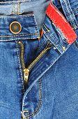stock photo of zipper  - Zipper detail of pants in jeans for men light blue color - JPG