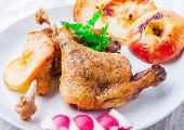 stock photo of roast duck  - Roasted duck leg with baked apples on white plate - JPG