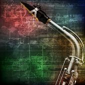 image of saxophones  - abstract green grunge vintage sound background with saxophone - JPG