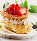 picture of cream puff  - Sweet cream puff with strawberries - JPG