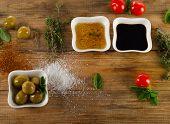 stock photo of vinegar  - Dressing ingredients on a rustic wooden background - JPG