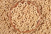 stock photo of cereal bowl  - Breakfast cereal rings in a wooden bowl - JPG