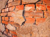 stock photo of fragmentation  - Fragment of an old shabby brick wall with wide angle fisheye lens view - JPG