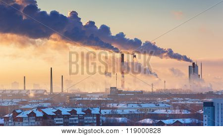 chimneys with smoke in the city at morning