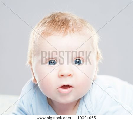 Portrait of a cute smiling infant baby. Happy childhood concept.