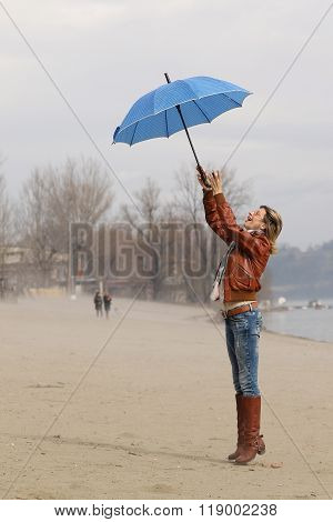 Wind Steal The Blue Umbrella From Girl