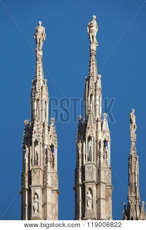 Marble statues of Saints on the spires of the Milan Cathedral (Duomo di Milano) in Milan, Lombardy, Italy.
