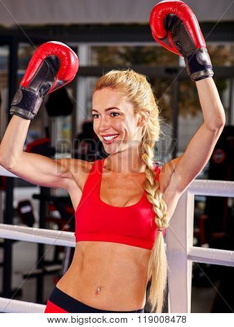 Portrait of sport girl hands up boxing wearing red gloves.