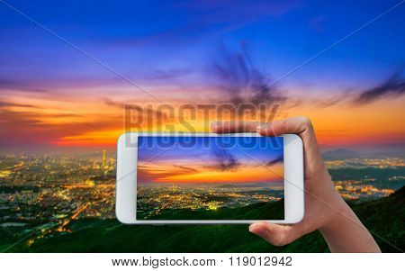 Hand Holding Smart Phone Take A Photo At South Korea Skyline Of Seoul, The Best View Of South Korea.
