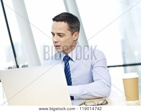 Businessman Working In Office With Laptop