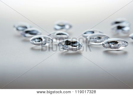 Glass Beads On Glass Table