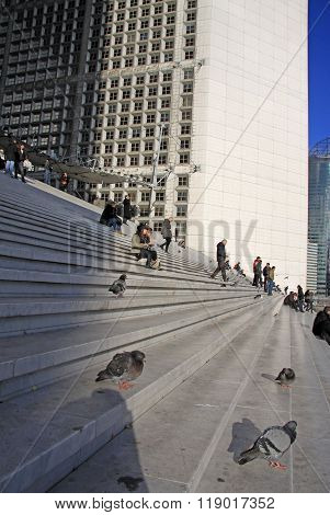 Paris, France -17 December 2011: Doves And People On The Stairs Of The Grande Arche In La Defense Di