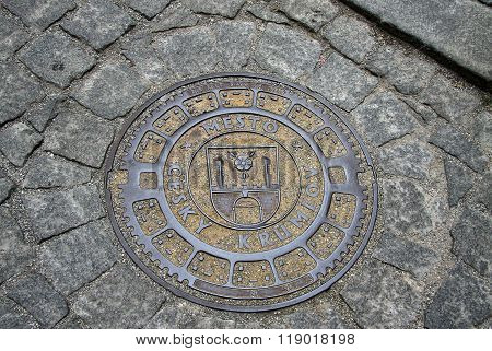 Cesky Krumlov, Czech Republic - May 01, 2013: Round Steel Sewer Manhole On Old Cobblestone Road In C