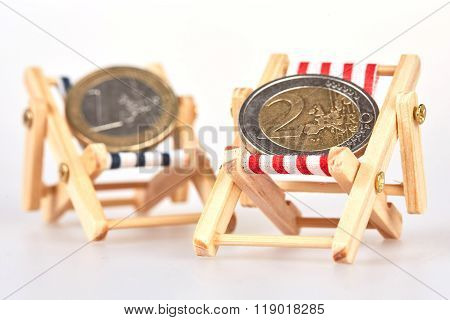 Euro Coins On Two Deckchairs