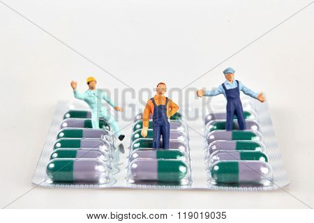 Little Figurines On A Pill Blister