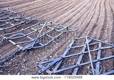 Agriculture Machinery Harrow Rake On Plowed Field