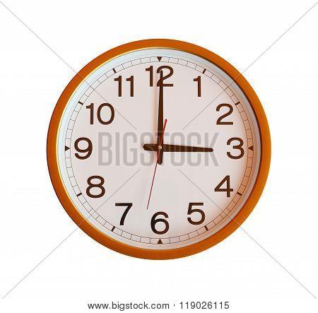 Orange Wall Clock Isolated In Three O'clock.