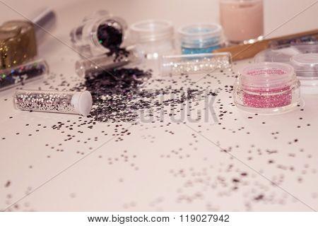 Manicure and pedicure tools, glitter.