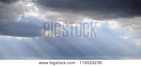 Light Rays Shine Through The Dark Clouds