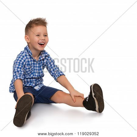 Boy sitting with legs apart
