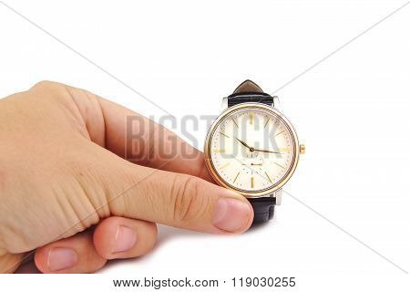 Close up of hand holding watch, isolated on white background. Time concept